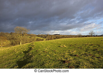 storm clouds over landscape - stormy skies and dramatic...