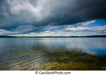 Storm clouds over Massabesic Lake, in Auburn, New Hampshire.