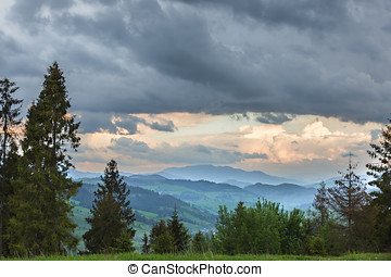 Storm clouds over mountains and the forest