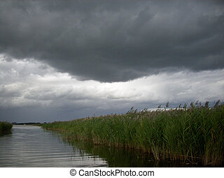 Storm clouds over reed bed - A Norfolk broad with reed...
