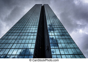 Storm clouds over the John Hancock Building, in Boston,...