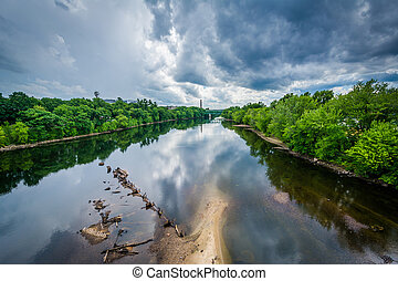 Storm clouds over the Merrimack River, in Manchester, New Hampshire.