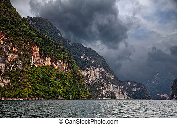 Storm clouds over the mountains and lake.