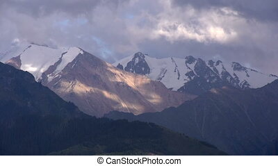 Storm clouds over the mountains - Snow-covered mountain...