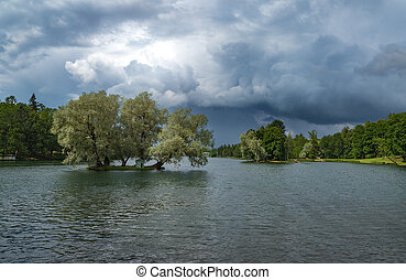 Storm clouds over the park in summer. Gatchina. Russia