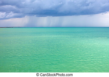 Storm clouds over the turquoise sea