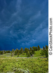 Storm clouds roll in over Yellowstone hill