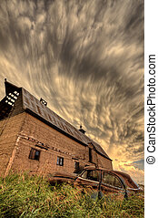 Storm Clouds Saskatchewan antique car and barn