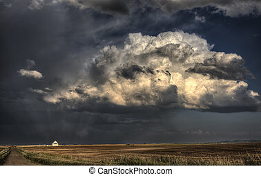 Storm Clouds Saskatchewan with country church at sunset
