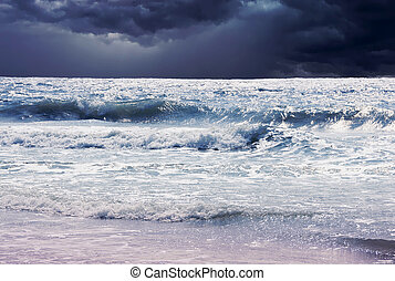 storm clouds with ocean surf