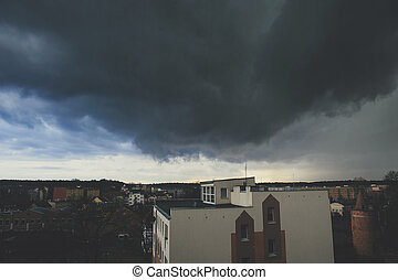 Storm dark clouds over city