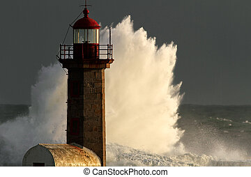 Storm waves over lighthouse of the harbor of river Douro, Portugal; end of the day light.