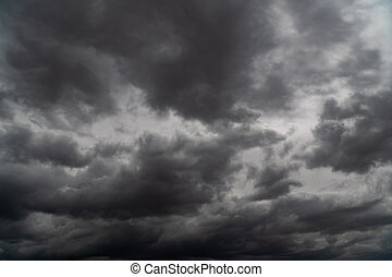 Storm is coming. Before heavy rain storm. On the sky is covered all over by the clouds. A lot of lightning and strong wind. The dark clouds is look like a big black smoke from erupting volcano