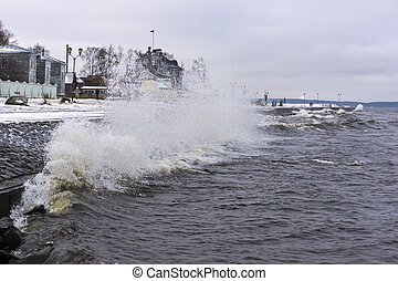 Storm on city lake quay in winter