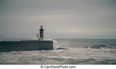 Storm on the Atlantic coast near the old lighthouse, Porto, Portugal.