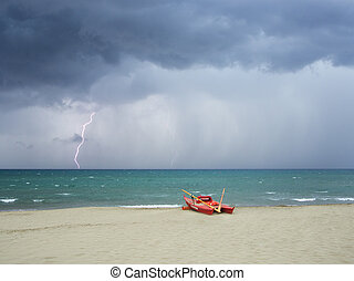 Storm on the beach, lightning falls into the sea