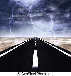 road with a thunder storm over it