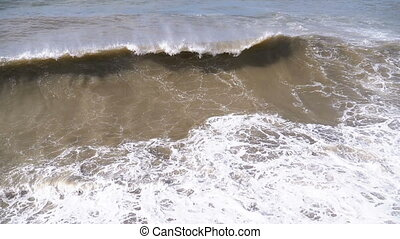 Storm on the Sea. Huge Waves are Crashing and Spraying on the Shore. Slow Motion