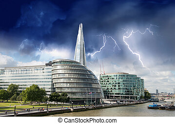 Storm over London city hall with Thames river, panoramic view from Tower Bridge - UK
