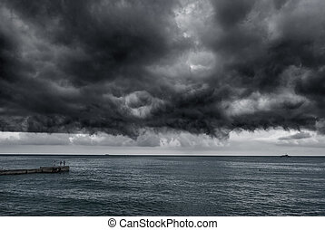 Storm over the sea - Black storm clouds hung over the sea