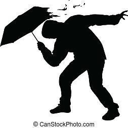 Storm Umbrella - A silhouette of a man's umbrella being torn...