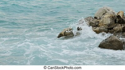 Storming Seacoast Rocks - Beautiful blue waves storming near...