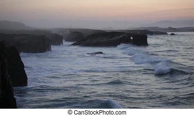 Storming waves during inflow at sunset on Playa de las...