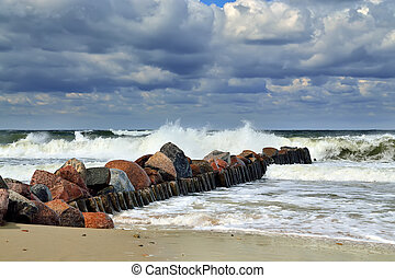 Stormy Baltic sea and breakwater