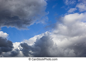 stormy clouds background image with blue sky on an autumn...