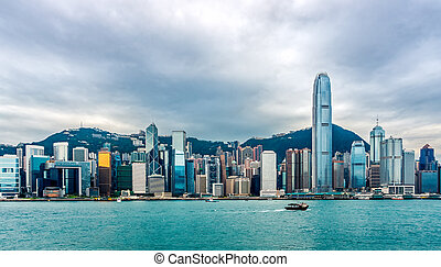Stormy clouds over Hong Kong bay, city skyline