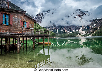 Stormy clouds over Pragser Wildsee lake in Dolomites, Europe