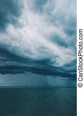 Stormy clouds over seascape, rainy season weather and...
