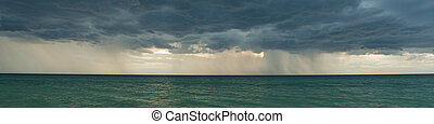 Stormy clouds panorama - Panorama of dark stormy clouds over...