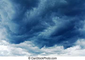 Stormy clouds - Dark stormclouds stretching towards the...