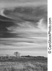Stormy clouds - Stormy landscape with heavy clouds and the...