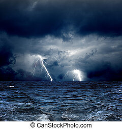 Stormy sea - Dramatic nature background - lightnings in dark...
