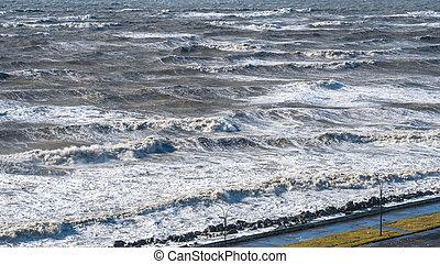 Stormy sea huge waves breaking near the coast