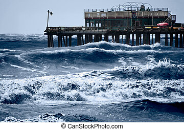 Stormy Seas - Strong storm driven waves pound the wharf