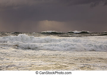 Stormy seascape at sunset