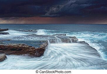 Stormy skies at sunrise - Stormy sunrise skies and turbulent...