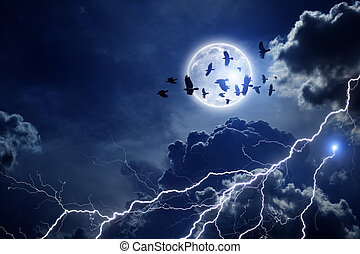 Stormy sky, flock of ravens - Night sky with full moon,...