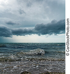 stormy sky over dark sea