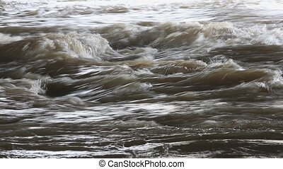 Stormy spring river close-up, Russia. - Landscape with a...