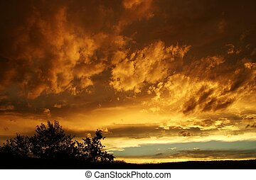 Stormy Sunset - The sun setting on gathering storm clouds in...