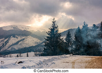 stormy weather over forest in mountains - stormy winter sky...