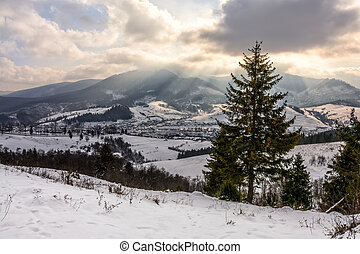 stormy weather over rural area in mountains - stormy winter...