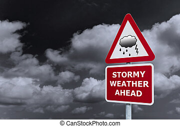 Stormy weather signpost - Concept image of a signpost with...