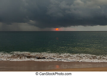 Stormy weather coastline during a sunset.