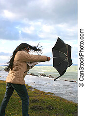 Stormy weather - Digital photo of a woman with an umbrella...