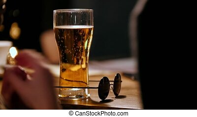 Story in bar - woman drink beer and talking with friend,...